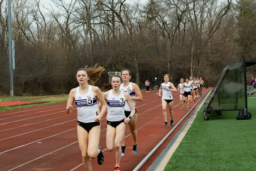 The Wildcats run. Junior Kelly O'Brien (No. 6) won the 1,500-meter race at Friday's NIU Huskie Classic.
