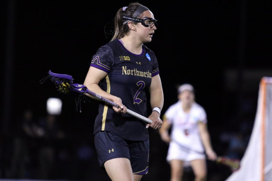 Selena+Lasota+holds+the+ball.+The+senior+attacker+scored+3+goals+in+Friday%27s+game+against+Maryland.