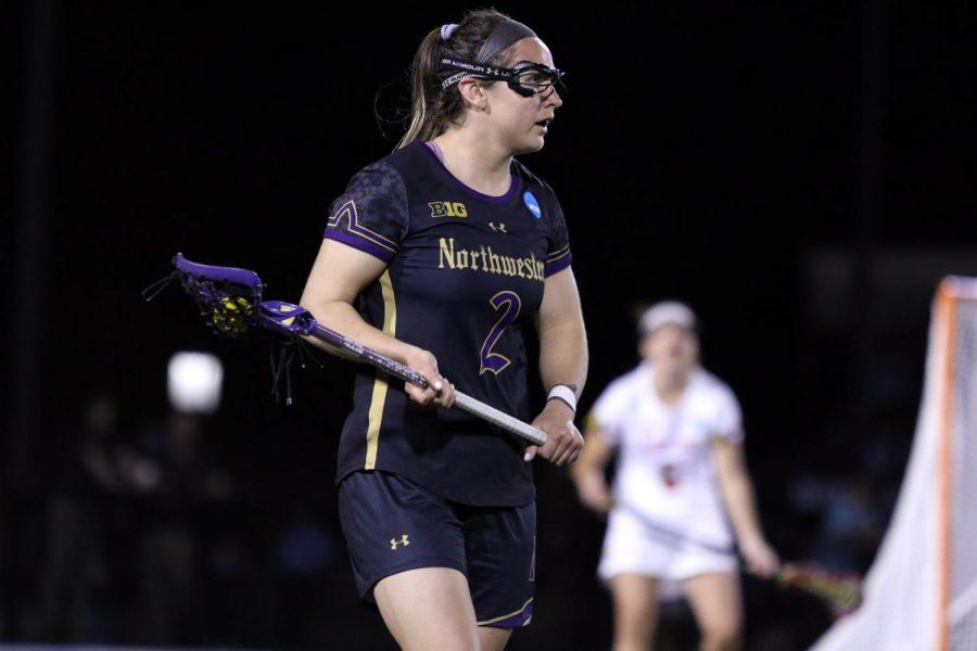 Selena Lasota holds the ball. The senior attacker scored 3 goals in Friday's game against Maryland.