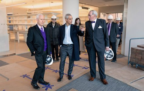 University president Morton Schapiro, Chicago Mayor Rahm Emanuel and dean of Feinberg School of Medicine Dr. Eric Neilson tour the Simpson Querrey Biomedical Research Center in January. The center is set to open in June.
