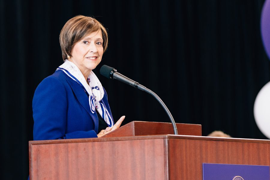 """Patricia Telles-Irvin, vice president for student affairs, speaks during convocation. Telles-Irvin passed away Monday after a """"long and valiant battle"""" with cancer."""