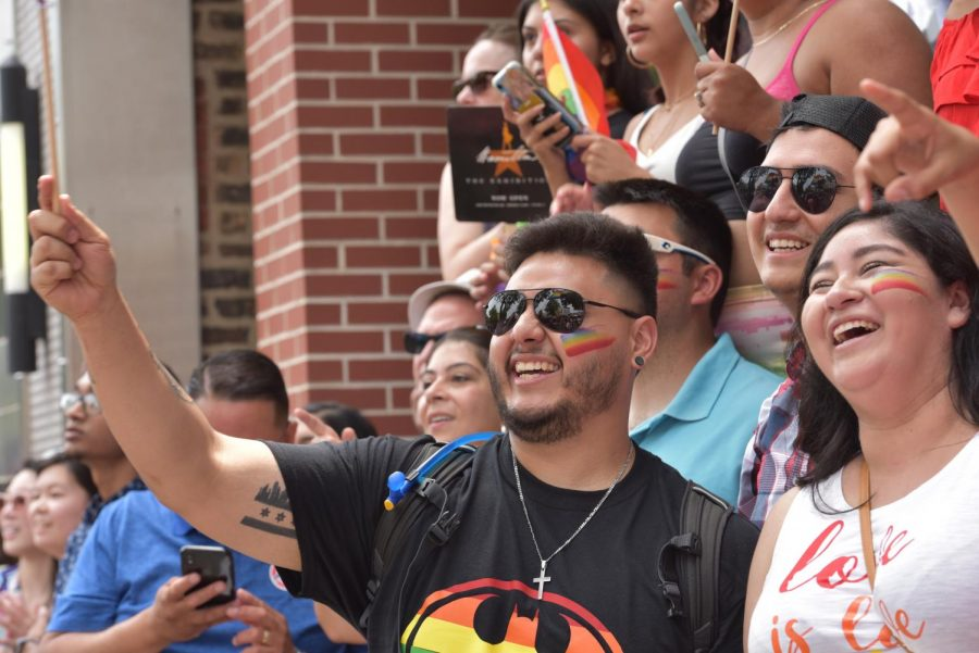 Illinois+residents+celebrate+the+LGBTQ+community+at+the+Chicago+pride+parade.+Illinois+Gov.+J.B.+Pritzker+signed+a+bill+Aug.+9+that+mandates+all+public+schools+in+the+state+to+teach+about+the+contributions+made+by+LGBTQ+people+to+state+and+U.S.+history.