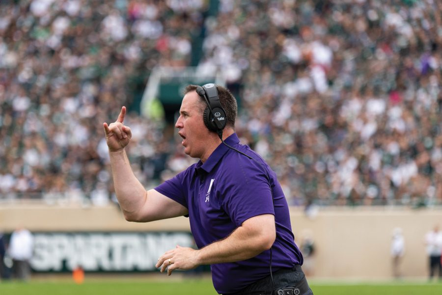 Pat Fitzgerald coaches from the sideline. Fitzgerald praised new offensive line coach Kurt Anderson and his team's success in close games at Big Ten Media Days on Friday.