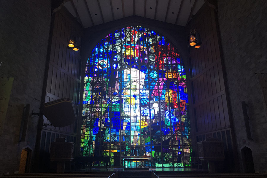 The chancel window behind the altar of the Alice Millar Chapel, designed by Benoit Gilsoul. The window represents creation, redemption and triumph.