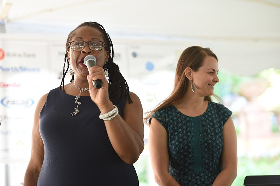 Maudlyne Ihejirika (left) emceed the fifth annual Taste of Evanston. This year's Taste raised funds for Connections for the Homeless and Reba Place Development Corporation.