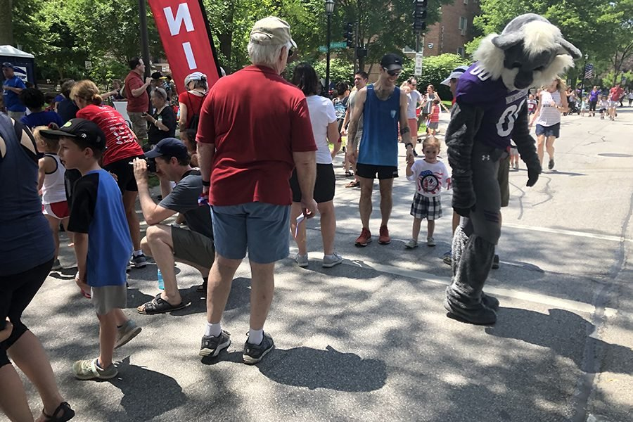 Six-year-old+Evanston+resident+Abel+McKenney+and+his+father%2C+Doug+McKenny.+The+two+approached+Willie+the+Wildcat+at+the+finish+line+of+the+Kids+Fun+Run.