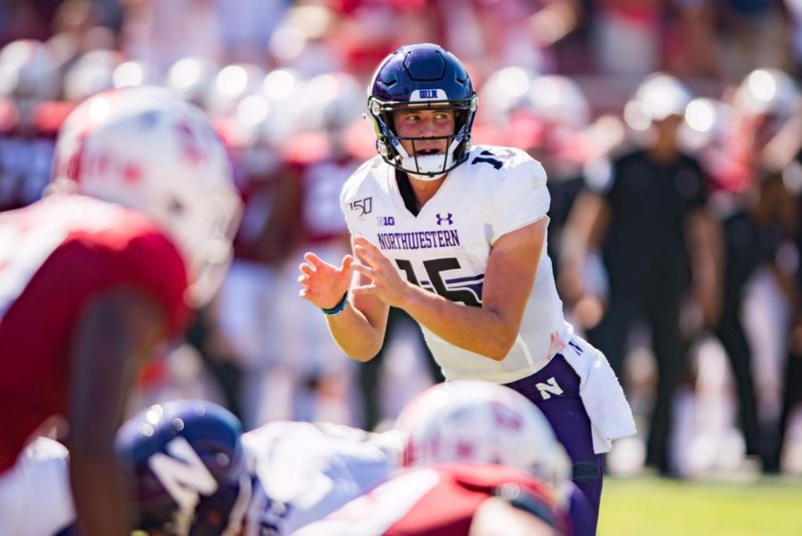 Hunter+Johnson+makes+a+pre-snap+read.+The+sophomore+transfer+went+6-for-17+in+his+first+game+for+the+Wildcats.
