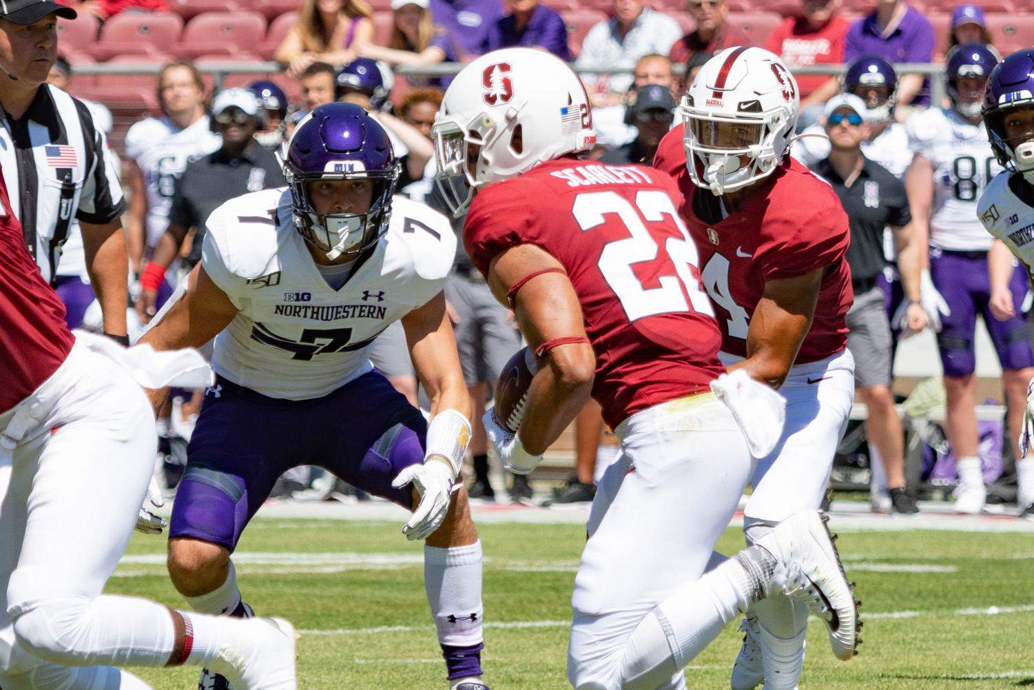 Travis Whillock stares down a Stanford running back. Whillock tied for the team lead with 10 tackles.