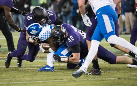 Paddy Fisher makes a tackle. The junior linebacker is NU's lone returning captain this season.