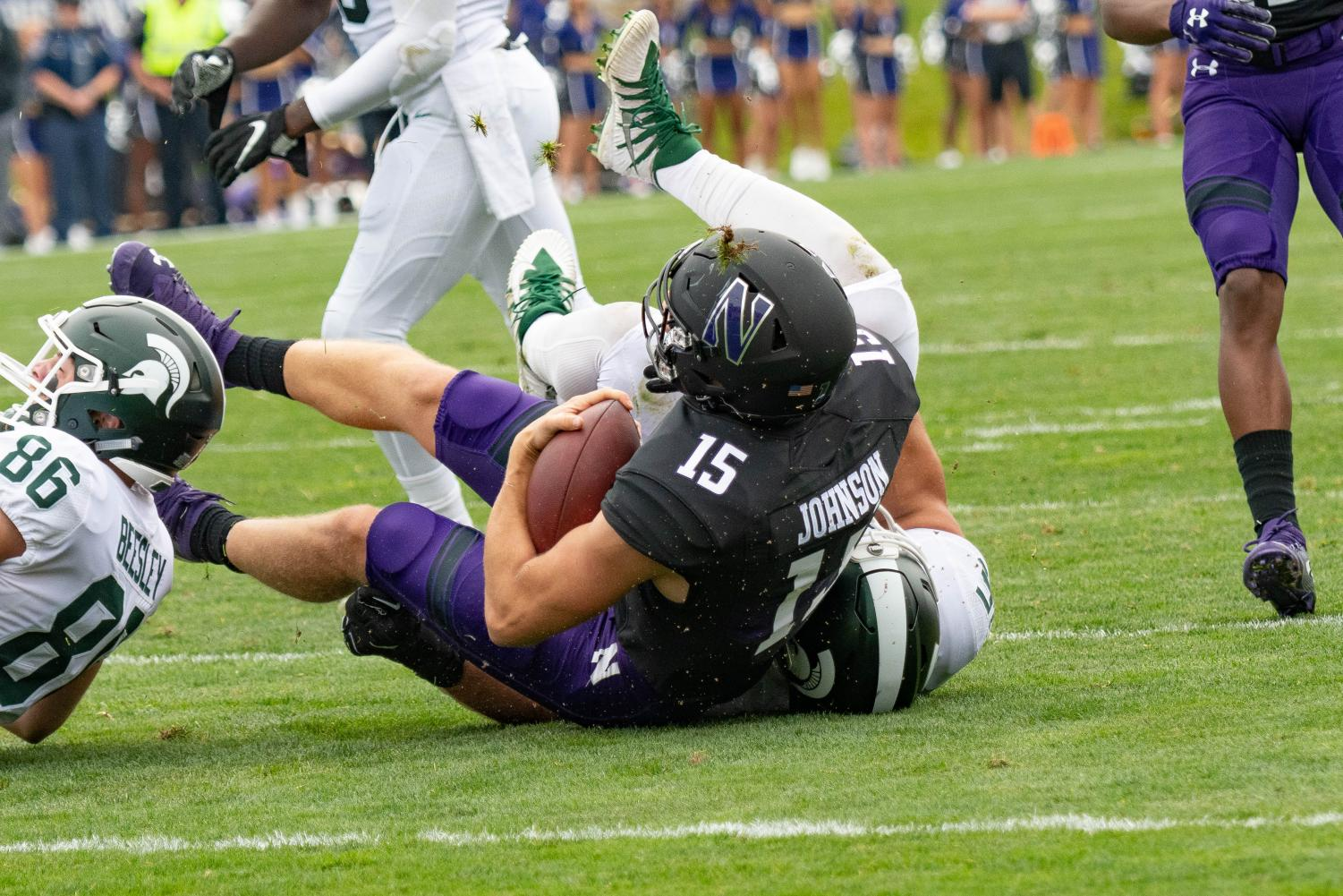 Hunter Johnson gets tackled in the backfield. The Northwestern offense struggled mightily in a loss to Michigan State.