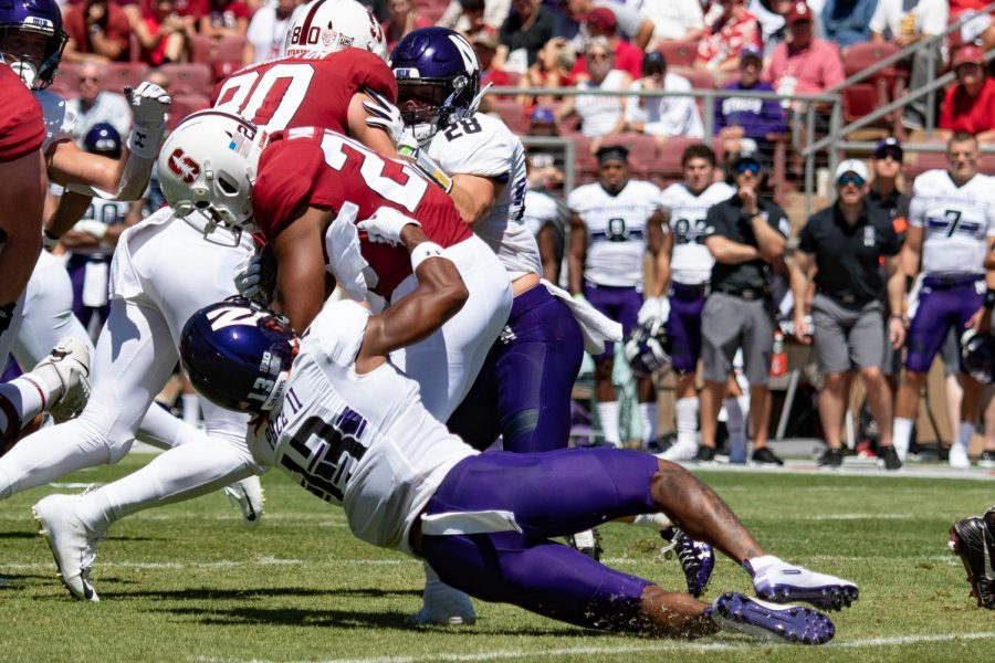 JR Pace makes a tackle. Coach Pat Fitzgerald said the defense had an outstanding performance Saturday.