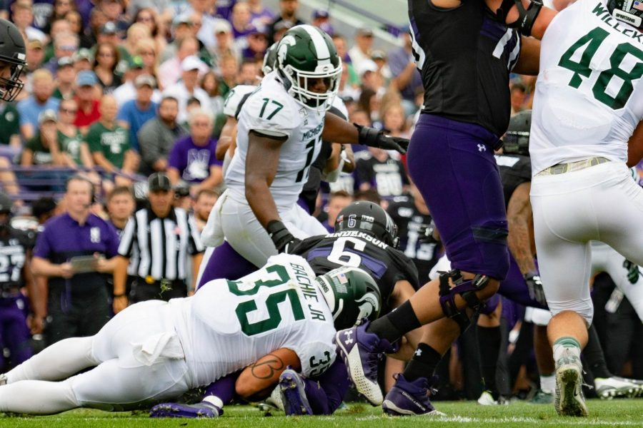 Michigan State's Joe Bachie tackles redshirt freshman Drake Anderson. Anderson led the Wildcats with 91 rushing yards.