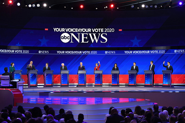 Ten+candidates+crowd+the+stage+during+the+third+round+of+debates+in+Houston.+More+than+10+candidates+have+qualified+for+the+fourth+round+of+debates+in+October%2C+which+will+take+place+over+two+nights.