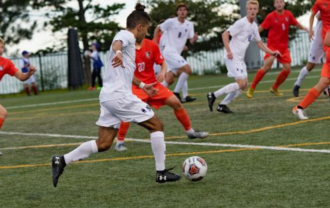 Bardia Kimiavi dribbles the ball through midfield. The sophomore has three goals and two assists this season.