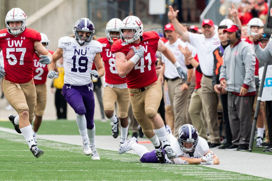 Riley Lees chases down a Wisconsin linebacker Noah Burks, who scored on a 68-yard pick six. Northwestern's offense turned the ball over three times and struggled throughout the day.