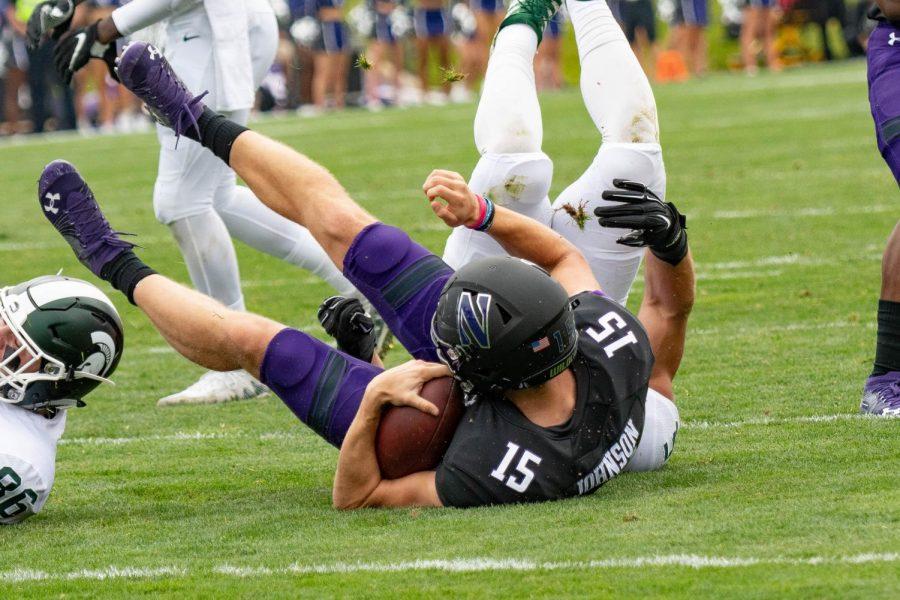 Hunter Johnson falls to the turf. The sophomore quarterback has struggled so far this season.