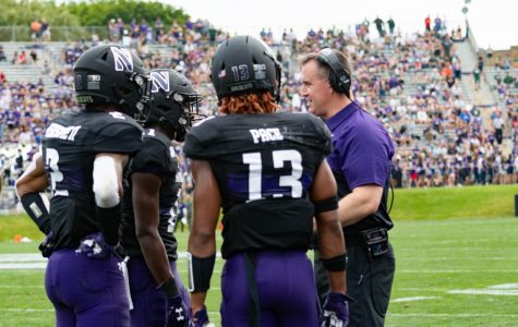 Pat Fitzgerald talks with members of the Northwestern secondary. The unit has battled injuries so far this season.