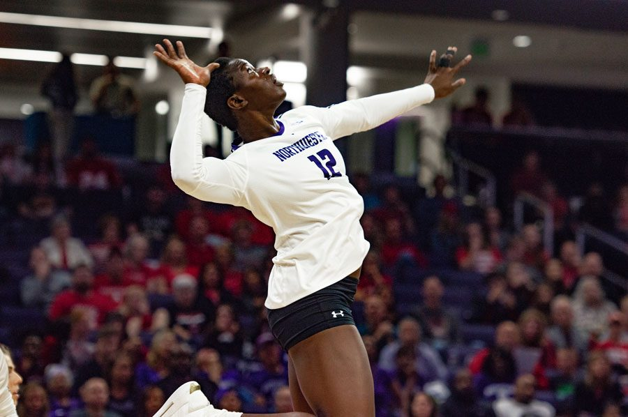 Temi Thomas-Ailara stares at her opponent. The freshman outside hitter led the team with 21 kills against Purdue.