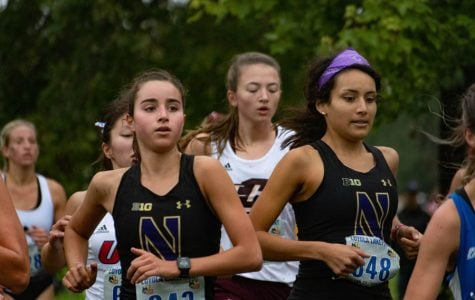 Kayla Byrne (left) runs in the Loyola Lakefront Invite. The freshman finished the 5K with a time of 19:14.03.