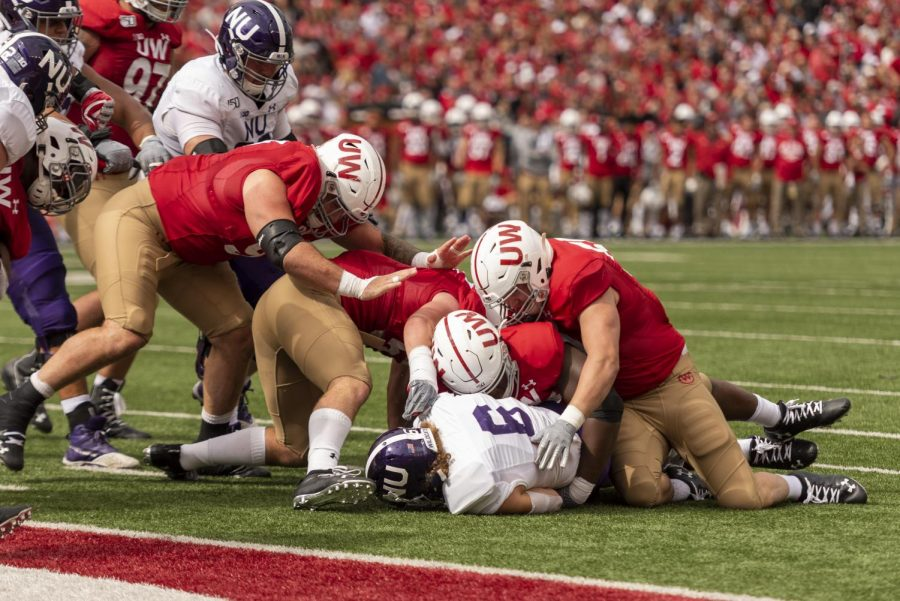 Drake Anderson gets tackled short of the goal line on a two-point conversion attempt. The Wildcats were 0-for-2 on such plays in their loss Saturday in Madison.