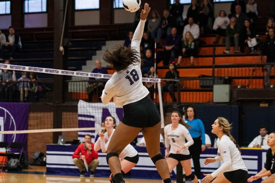 Nia Robinson hits the ball. The junior outside hitter is second on the team in points.