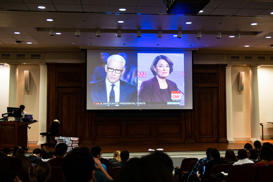 Students watch the Democratic Presidential Debate at Harris Hall. The presidential hopefuls debated topics such as the impeachment, the Middle East, health care, and gun control.