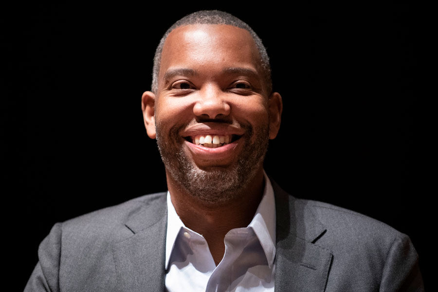 """Author and journalist Ta-Nehisi Coates speaks at Evanston Township High School. Coates took part in a conversation with writer Hanif Abdurraqib about his new book, """"The Water Dancer,"""" which was attended by nearly 1500 people."""