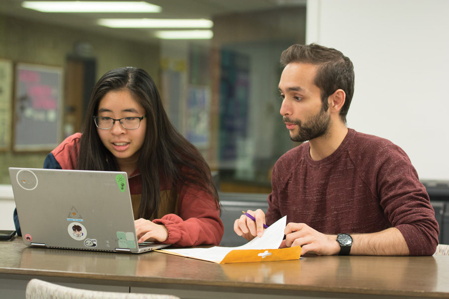 Andrea Lin and Khizar Nandoliya edit essays in Norris. The two Northside College Prep alumnae created an editing service for CPS seniors affected by the strike.