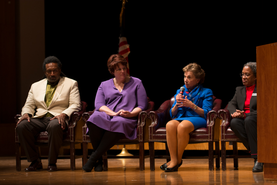 Four speakers address a crowd during a Q&A. The event, hosted by the Democratic Party of Evanston, focused on hate speech in the United States.