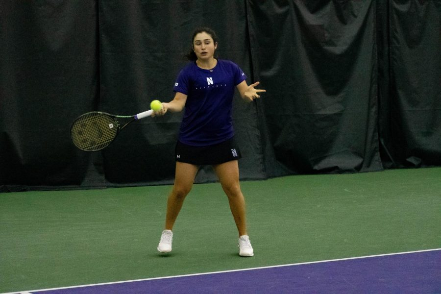 Inci+Ogut+hits+the+ball.+The+sophomore+won+the+championship+match+of+her+portion+of+the+bracket+during+the+Wildcat+Invite.