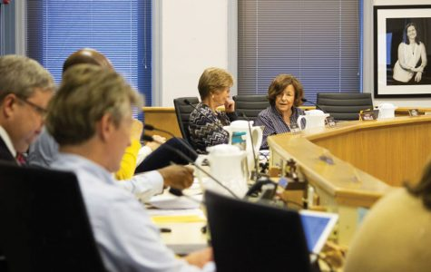 City Council members engage in discussion. At a Monday Rules Committee meeting, aldermen discovered the city never formally switched to nonpartisan elections.