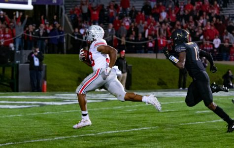 Northwestern cornerback A.J. Hampton chases after Ohio State's Master Teague III en route to a 73-yard touchdown. The Buckeyes demolished the Wildcats 52-3 Friday at Ryan Field.