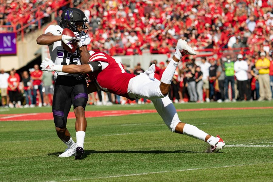 JJ Jefferson is tackled by the Nebraska defender. The wide receiver had four catches for 25 yards.