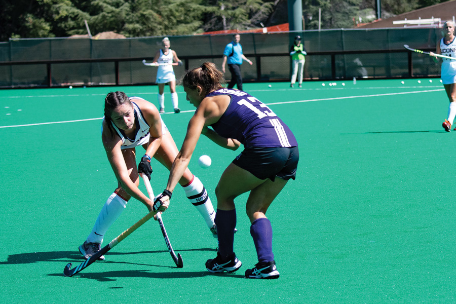 Lily Gandhi reaches for the ball. The senior midfielder has started every game this season.