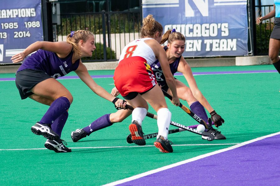Midfielders Peyton Halsey and Shannon Daley reach for the ball. Both players started the game against Maine on Sunday.