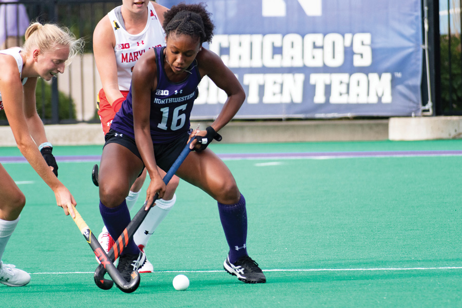 Junior Midfielder Christen Conley battles for the ball against No. 2 Maryland. The Wildcats have a big game this weekend against Iowa.