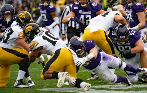Blake Gallagher makes a tackle on an Iowa runner. The junior linebacker led the team with 10 tackles.