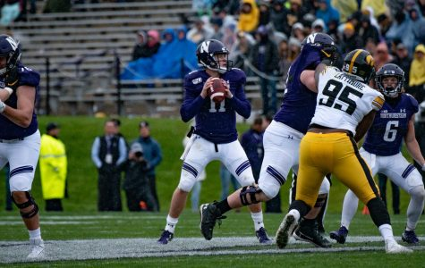 Aidan Smith looks for a receiver. The junior quarterback threw for 138 yards and an interception on Saturday.