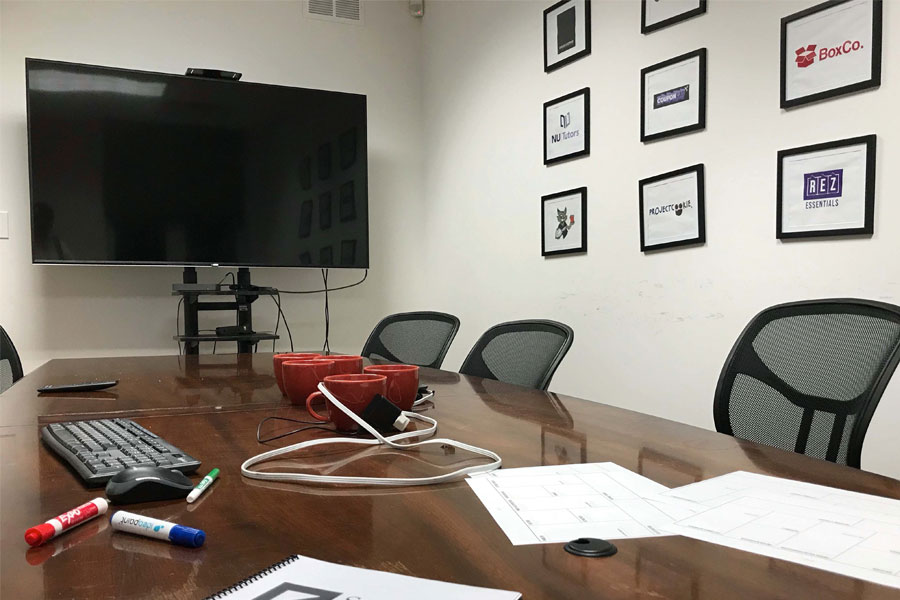 The boardroom in Student Holdings' new office space. The independent nonprofit split away from Northwestern club status in 2017.