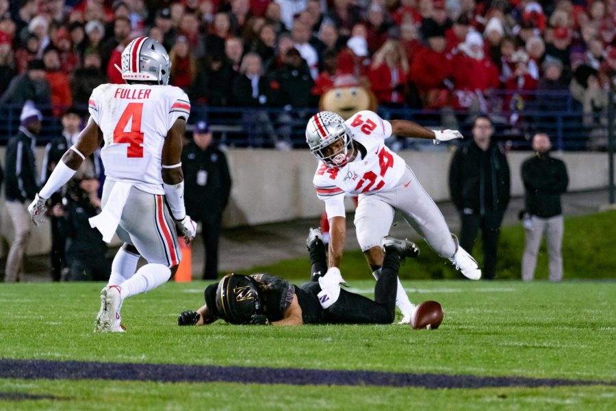 Riley Lees pounds the Ryan Field grass in frustration after dropping a pass. Northwestern was outplayed throughout Friday night's  home game against the visiting Buckeyes.