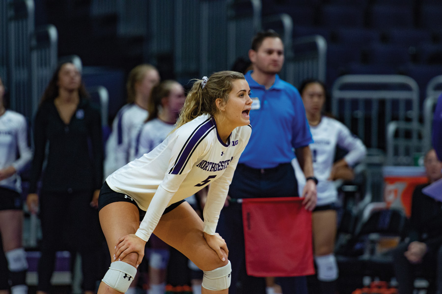 Emily Ehman talks to her teammates. The senior libero recorded seven digs in Wednesday's loss to Maryland.