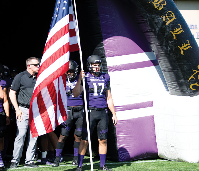 Dan Kubiuk prepares to lead Northwestern out of the tunnel before its home opener against UNLV. The sixth year senior has dealt with multiple catastrophic injuries and has played multiple sports in his career at NU.