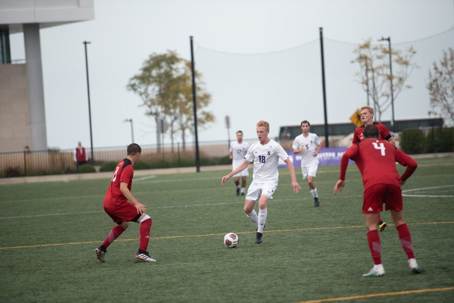 Sean Lynch dribbles the ball past center field against Rutgers. Lynch has started in four games this season, assisting once.