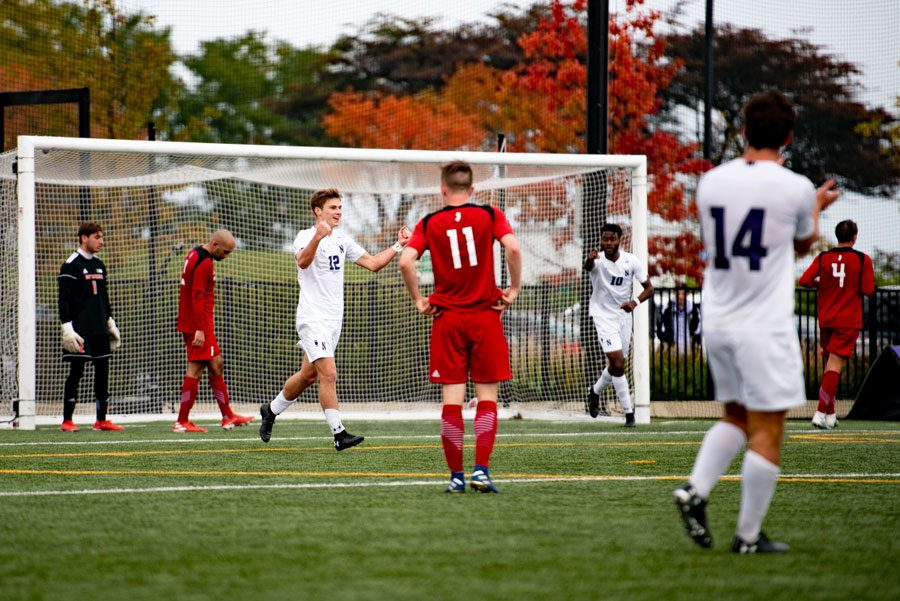 Logan+Weaver+celebrates+his+goal.+The+freshman+defender+gave+the+Cats+a+2-0+lead+in+the+first+half.