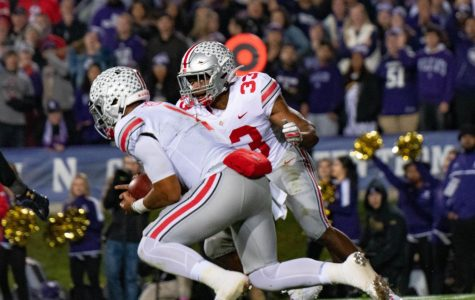 Ohio State quarterback Justin Fields sprints forward. The sophomore powered the Buckeyes to a blowout win over Northwestern on Friday.