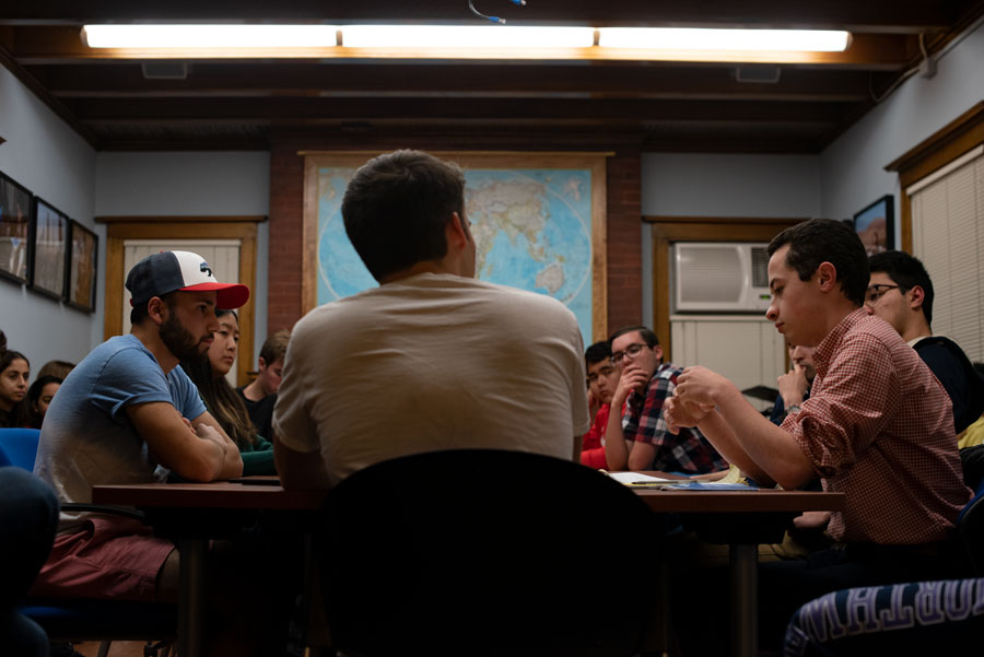 Students at a Political Union meeting. The group voted in favor of impeaching President Donald Trump.