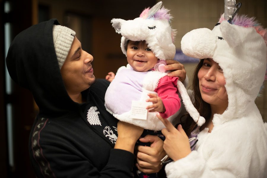 Abigail+Hernandez+and+Hector+Baez+pose+with+their+six+months+old+daughter+Daenerys+at+Project+Pumpkin+on+Tuesday.+Hernandez+lives+in+downtown+Chicago+and+said+Project+Pumpkin+is+a+much+safer+alternative+to+typical+Halloween+festivities.