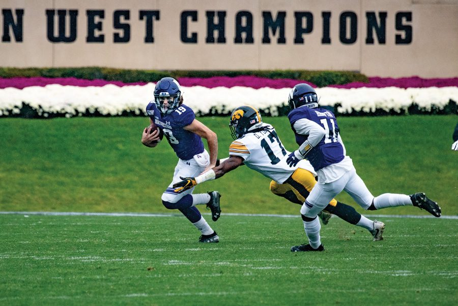 Riley Lees breaks a tackle. The junior has led Northwestern in receiving yards so far this season.