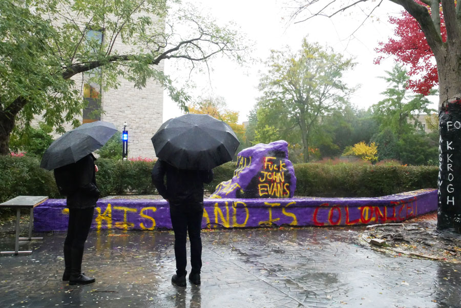 Passersby view the Rock, which was painted Homecoming weekend and criticized Northwestern's inaction following student demands to remove University founder John Evans' name from campus buildings.