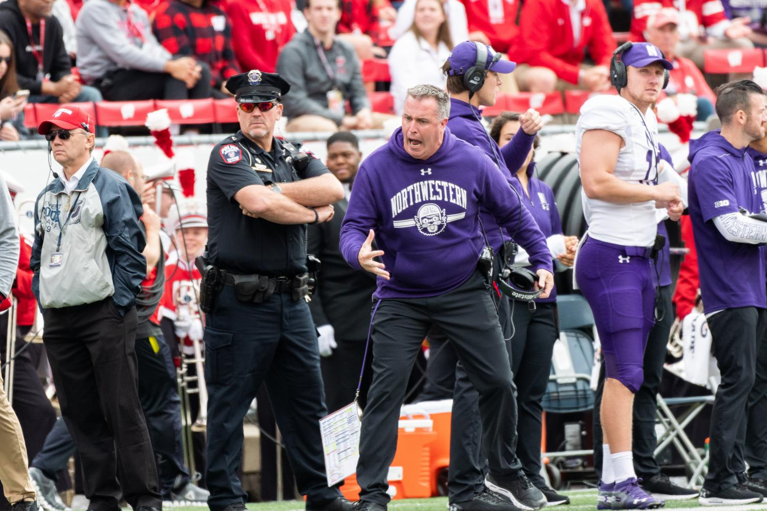 Pat Fitzgerald encourages his team. The Wildcats will play at Nebraska on Saturday in what amounts to a must-win game.